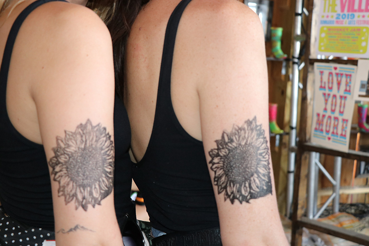 A Bonnaroo attendee shows off her temporary tattoo on June 15. Nashville printmaker Hatch Show Print brought several small carvings and used ink to apply temporary tattoos.
