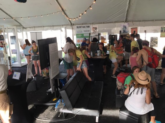 Patrons learn about the Bonnaroo Works Fund and bid on one-of-a-kind items at the Fund's Community Center.